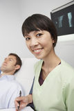 Happy Nurse With Men Lying On Bed Stock Images