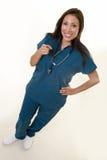 Happy nurse pointing Stock Image