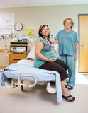 Happy Nurse With Pregnant Woman In Hospital Room Stock Photo