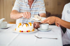 Happy nurse serving a dessert to his patient Stock Images