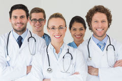 Happy nurses and doctors in hospital Stock Images