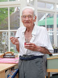 Happy nursing home resident eating stock photos