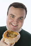 Happy Obese Man Holding Donut Stock Photo