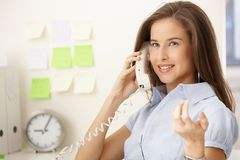 Happy office girl on call Stock Images