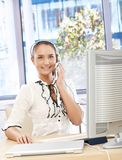 Happy office girl with headset Stock Image