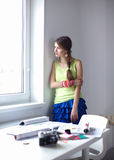 Happy office girl standing near wall Royalty Free Stock Images