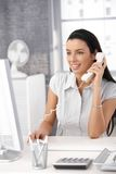 Happy office girl at work Stock Photo