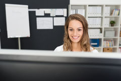 Happy Office Girl Working with her Computer Royalty Free Stock Photos