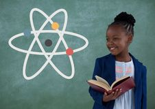 Happy office kid girl holding a book against green background with science icon Stock Photo