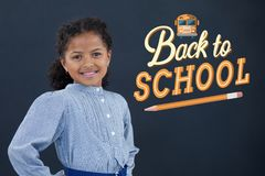 Happy office kid girl standing against blue background with back to school illustration Royalty Free Stock Images