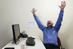 Happy Office Worker. One happy businessman at work stock photography