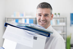 Happy office worker carrying boxes Royalty Free Stock Photo