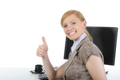 Happy office worker at his desk. Royalty Free Stock Photo
