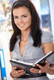 Happy office worker with personal organizer Stock Photo