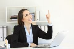 Happy office worker pointing above. To a blank space Stock Image