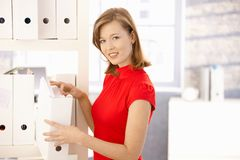 Happy office worker searching in folders Stock Photos