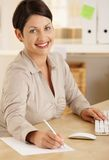 Happy office worker taking notes Stock Images