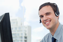 Happy office worker using a headset Royalty Free Stock Photos