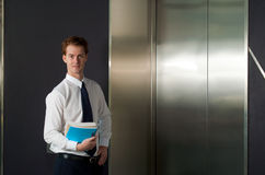 Happy Office Worker Waiting Elevator Horizontal Stock Images