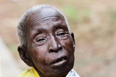 A happy old African woman with a full head of grey hair stock photography