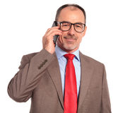 Happy old businessman talking on the phone Royalty Free Stock Images