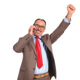 Happy old businessman winning on the phone Royalty Free Stock Images
