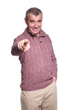 Happy old casual man pointing his finger. To the camera on white background Stock Photo