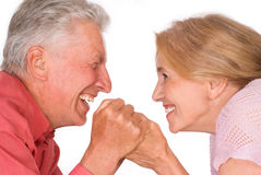 Happy old couple. Cute elderly couple smiling on a white Royalty Free Stock Images