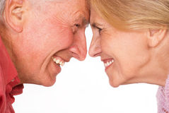 Happy old couple. Cute elderly couple smiling on a white Royalty Free Stock Image
