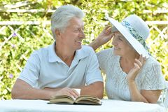 Happy old couple with  book Stock Photo