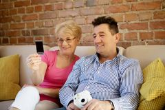 Happy old couple with camera. Happy old couple with camera looking on picture Royalty Free Stock Image