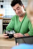 Happy old couple with camera. Happy old couple with camera looking on picture Royalty Free Stock Images