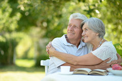 Happy old couple with drink Stock Images