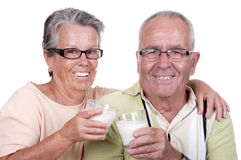 Happy old couple drinking milk Royalty Free Stock Image
