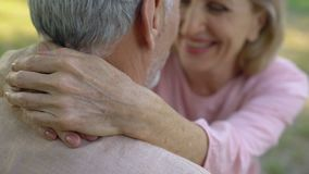 Happy old couple embracing, comfortable retirement, secure old age