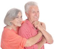 Happy old couple embracing on a white background. Portrait of a happy old couple embracing on a white background Stock Image