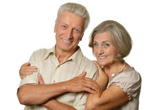 Happy old couple embracing on a white background. Portrait of a happy old couple embracing on a white background Royalty Free Stock Images
