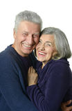 Happy old couple embracing on a white background. Portrait of a happy old couple embracing on a white background Stock Photography