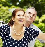 Happy old couple with flower. Royalty Free Stock Photo