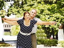 Happy old couple with flower. Royalty Free Stock Photography