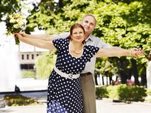 Happy old couple with flower. Royalty Free Stock Image