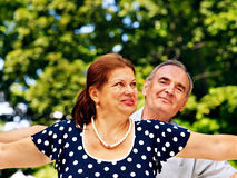 Happy old couple with flower. Royalty Free Stock Photos