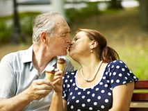 Happy old couple with ice-cream. Royalty Free Stock Images