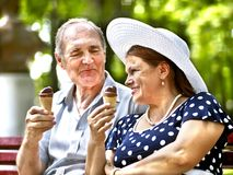 Happy old couple with ice-cream. Royalty Free Stock Photos