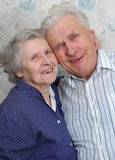 Happy old couple laugh until one cries Stock Photos