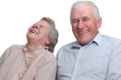 Happy old couple laugh until one cries. Isolated on white Royalty Free Stock Photo