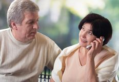 Happy old couple on mobile phone Stock Photos