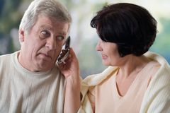 Happy old couple on mobile phone Stock Image