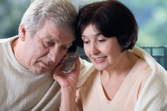 Happy old couple on mobile phone Stock Images