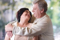 Happy old couple, outdoor. Happy mature couple embracing, outdoor Royalty Free Stock Image